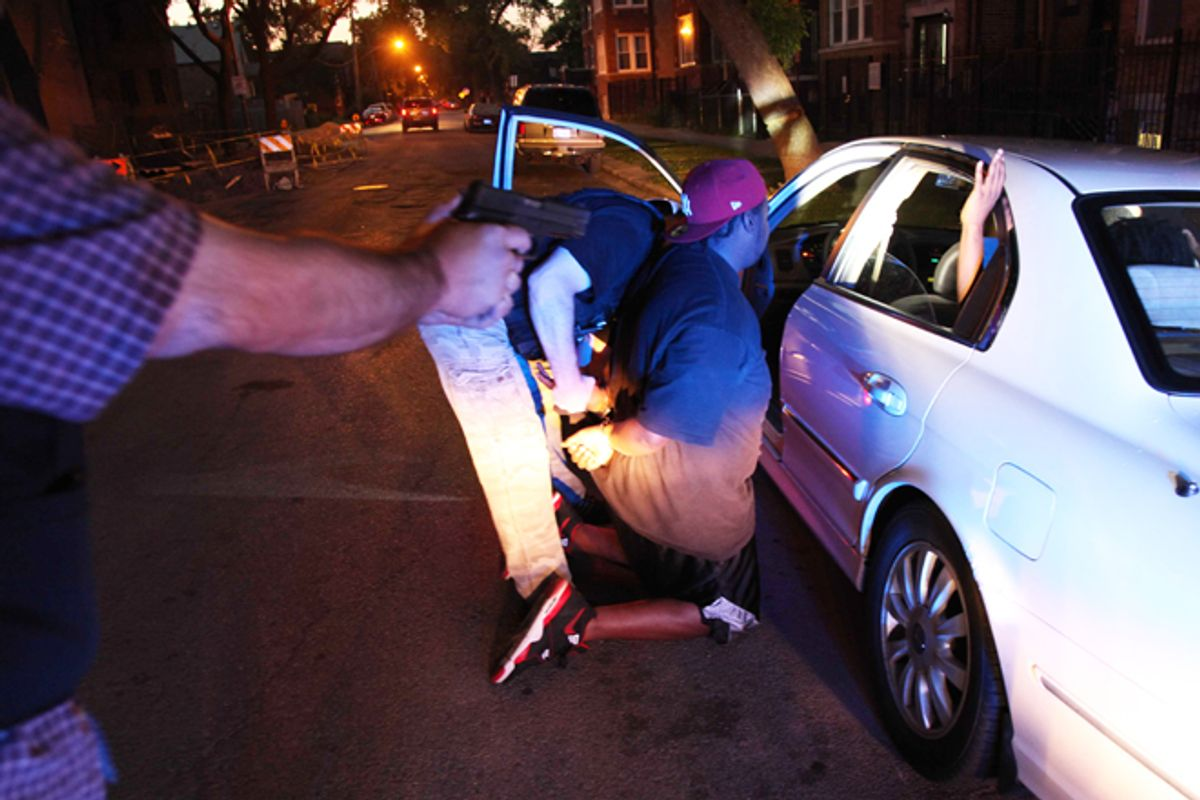 Chicago police arrest a gang member on an outstanding warrant on June 9.     (AP/Robert Ray)