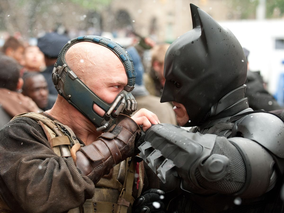 """(L-r) TOM HARDY as Bane and CHRISTIAN BALE as Batman in Warner Bros. Pictures' and Legendary Pictures' action thriller """"THE DARK KNIGHT RISES,"""" a Warner Bros. Pictures release. TM and © DC Comics   (Ron Phillips)"""