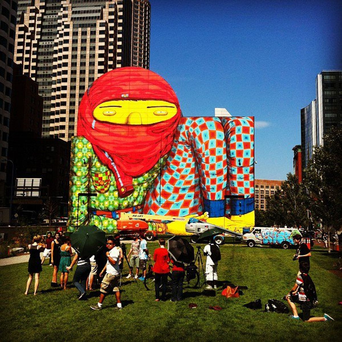 A new Os Gemeos painting rises on Boston's Rose Fitzgerald Kennedy Greenway at Dewey Square to coincide with their show at the city's Institute for Contemporary Art (via Geoff Hargadon's Instagram)