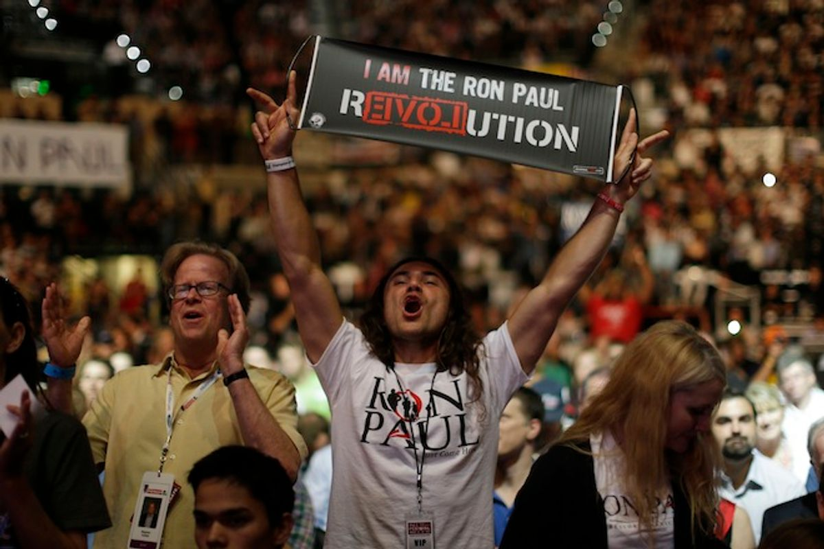 Supporters of Rep. Ron Paul, R-Texas, rally at the University of South Florida Sun Dome on the sidelines of the Republican National Convention in Tampa, Fla., on Sunday, Aug. 26, 2012. (AP Photo/Charles Dharapak)  (AP/Charles Dharapak)