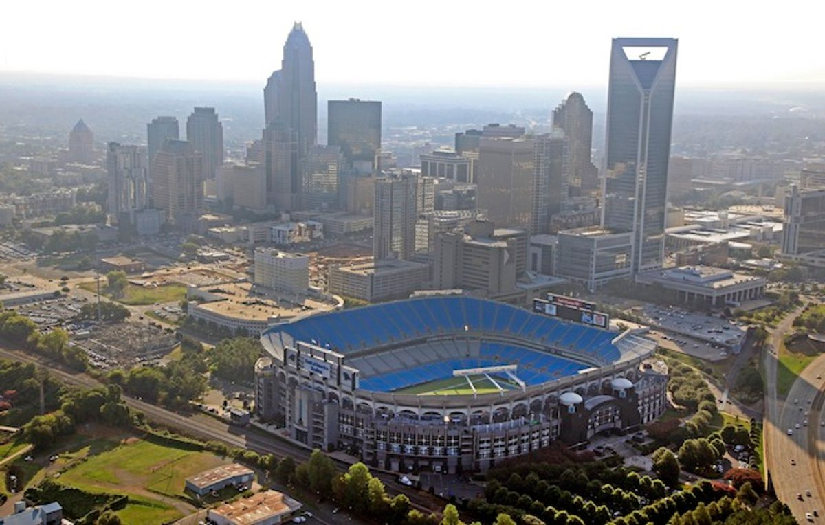 Bank of America Stadium is shown by the skyline of downtown Charlotte, N.C., Thursday, Aug. 16, 2012. The stadium is one of the sites of the Democratic National Convention. The convention starts on Sept. 3, 2012.            (AP/Chuck Burton)