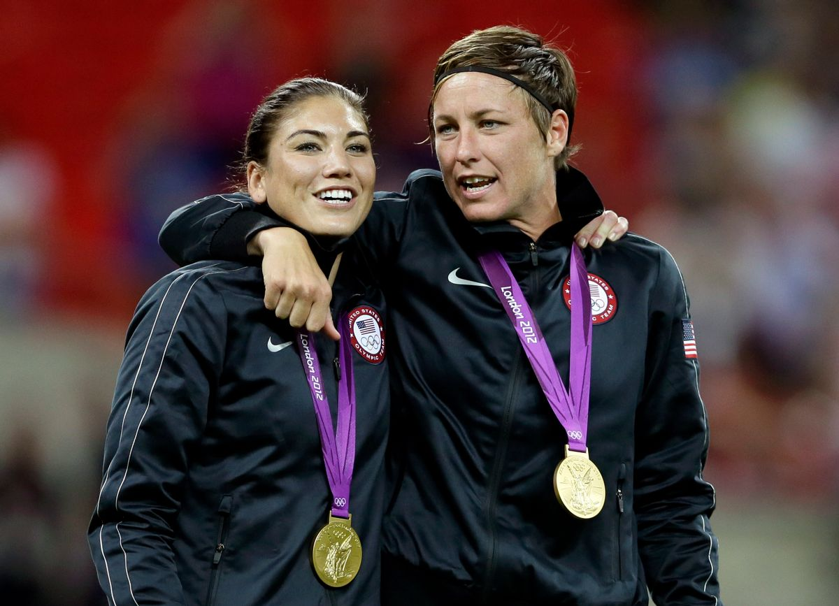 Abby Wambach, right, and teammate Hope Solo celebrate winning the gold medal during in the women's soccer final against Japan    (AP/Kirsty Wigglesworth)