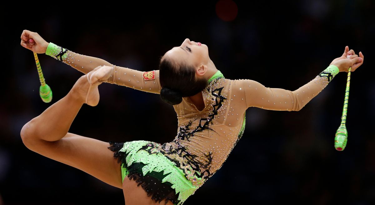 Russia's Daria Dmitrieva during the rhythmic gymnastics individual all-around qualifications at the 2012 Summer Olympics.     (AP/Gregory Bull)