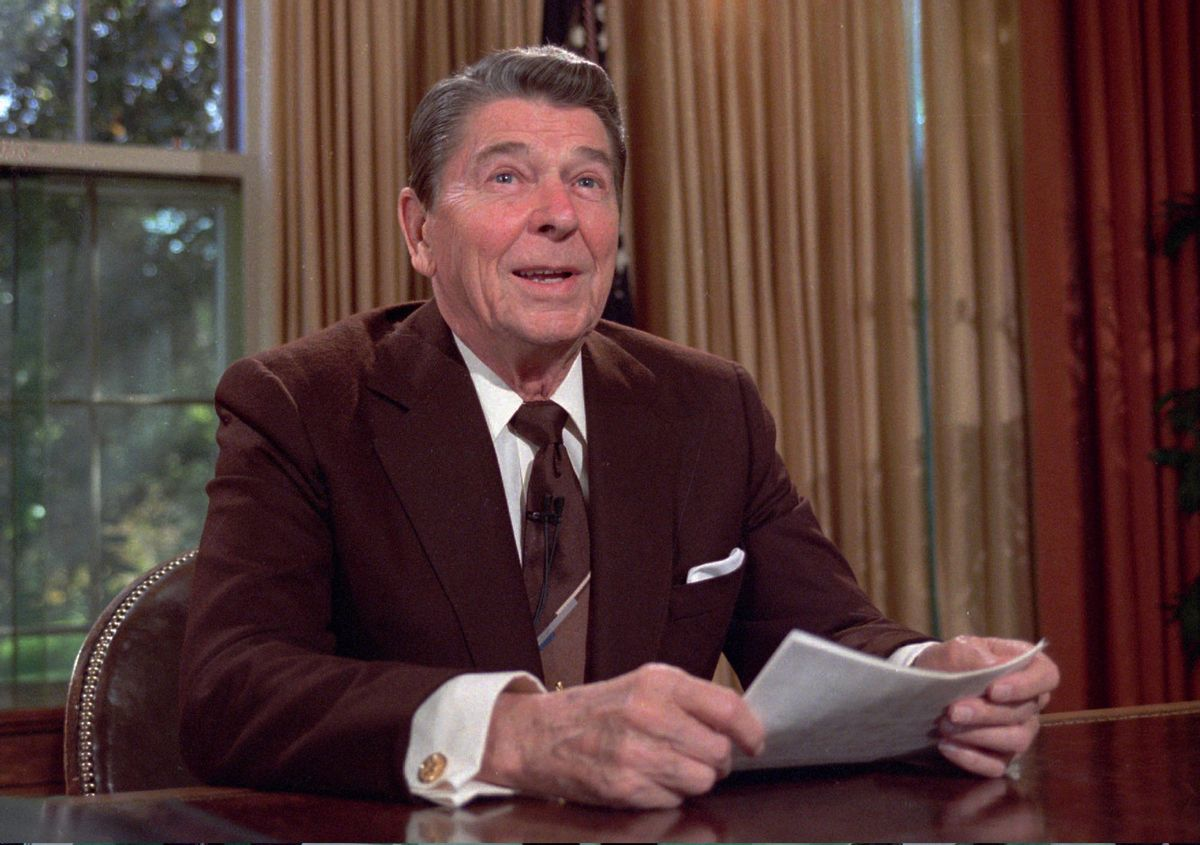 President Ronald Reagan works at his desk in the Oval Office of the White House as he prepares a speech on tax revision  in this May 24,1985 photo. It is reported that Reagan died on Saturday, June 5, 2004 at 93.  (AP Photo/Scott Stewart)   (AP)