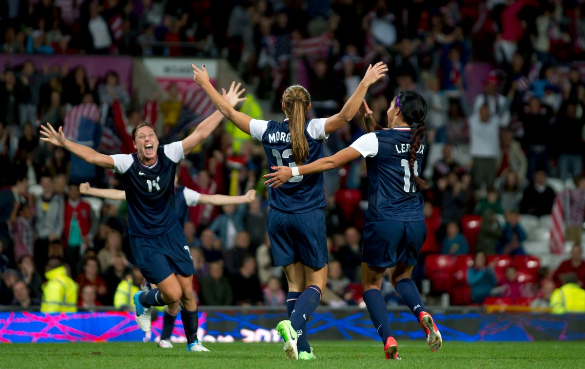 United States' Alex Morgan, center, celebrates with teammates including Abby Wambach, left, and Sydney Leroux after the winning goal was scored past Canada's goalkeeper Erin Mcleod during their semifinal women's soccer match at the 2012 London Summer Olympics, Monday, Aug. 6, 2012, at Old Trafford Stadium in Manchester, England. (AP Photo/)       (AP/Jon Super)