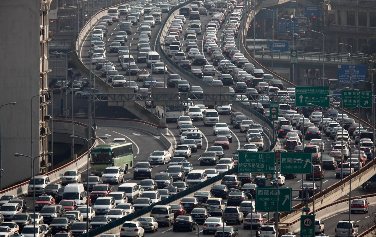 Heavy traffic on a highway during the morning rush hours in Shanghai   (Carlos Barria/Reuters)