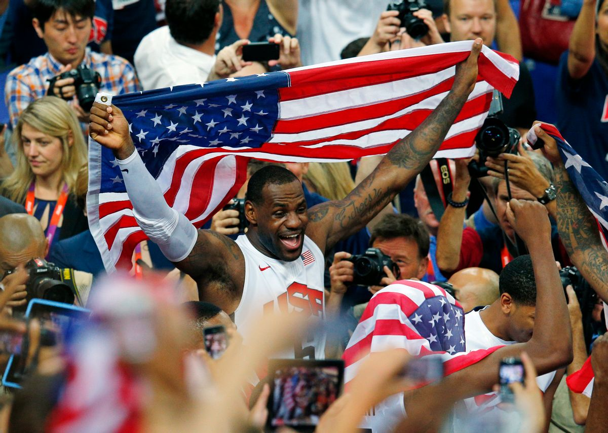 LeBron James of the U.S. celebrates with the flag after a victory against Spain in the men's gold medal basketball game     (Reuters/Brian Snyder)