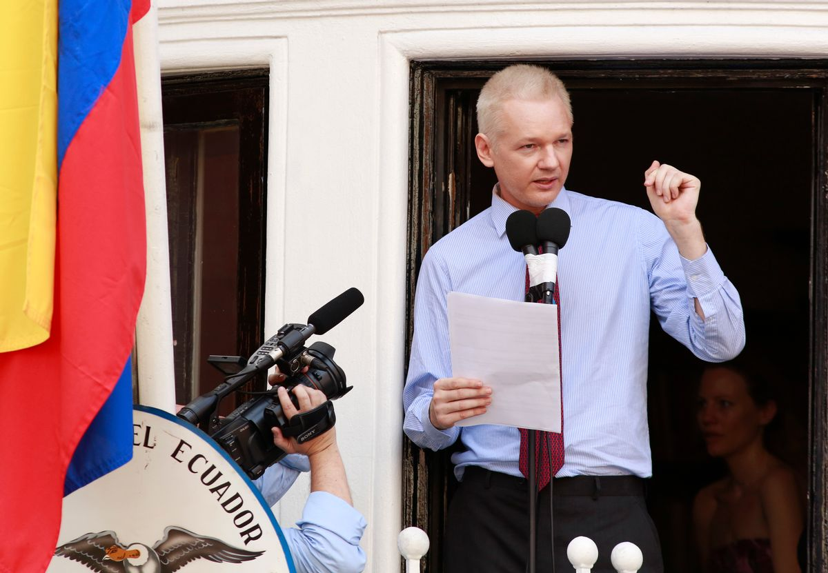 Assange used the balcony of Ecuador's London embassy on Sunday to berate the United States for threatening freedom of expression.       (Olivia Harris/Reuters)