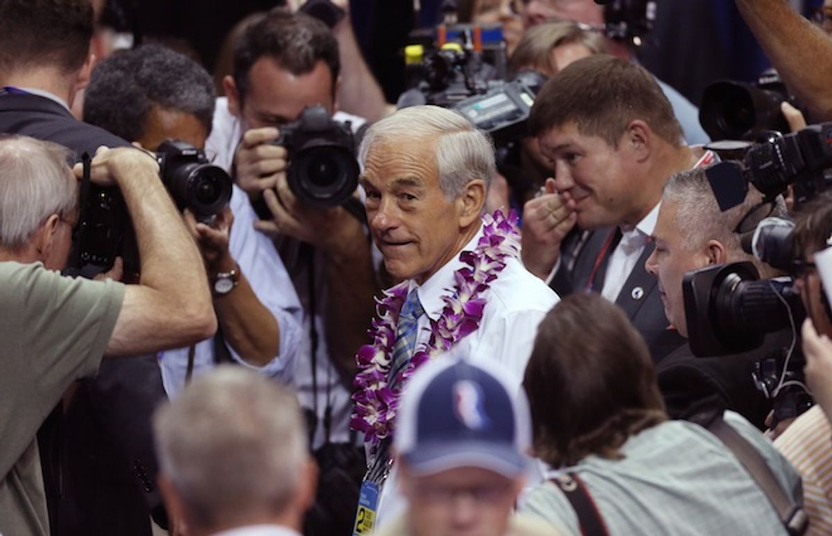 Former Republican presidential candidate, Representative Ron Paul (R-Tx), greets convention goers as he walks the floor before the start of the second session of the 2012 Republican National Convention in Tampa, Florida, August 28, 2012.       (Reuters/Jason Reed)
