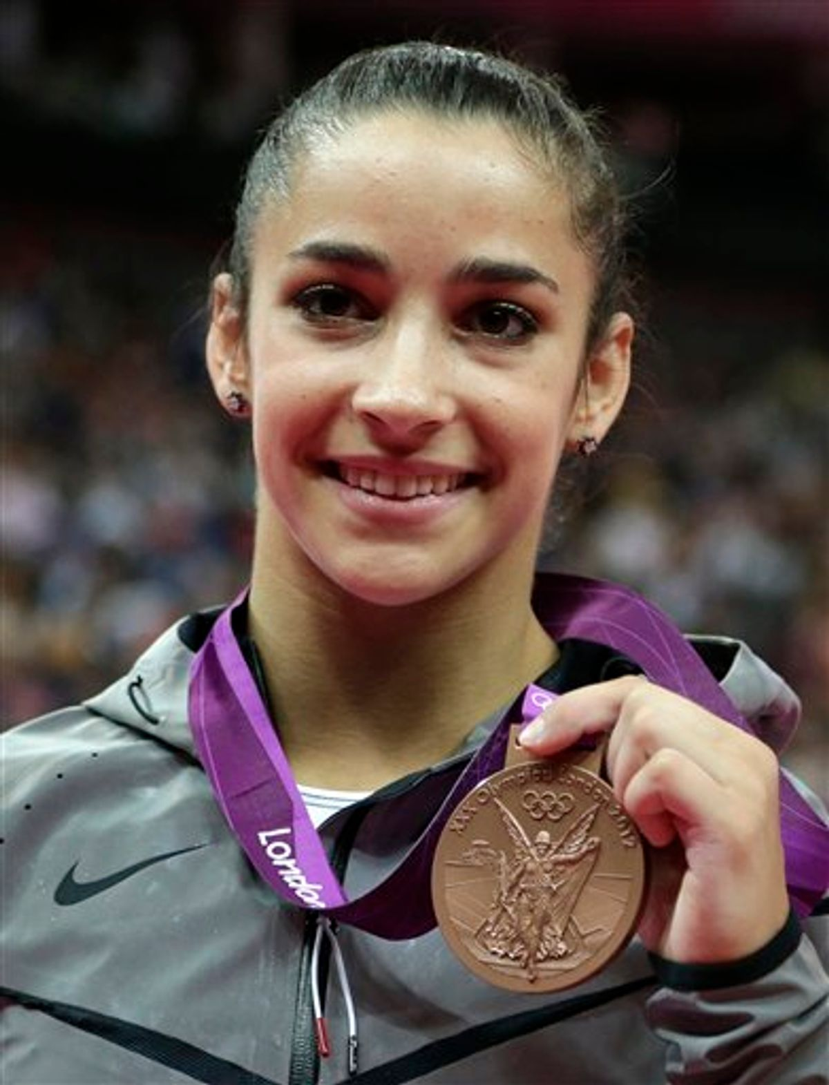 U.S. gymnast Alexandra Raisman displays her bronze medal for the balance beam during the artistic gymnastics women's apparatus finals at the 2012 Summer Olympics, Tuesday, Aug. 7, 2012, in London. (AP Photo/Gregory Bull)    (AP)