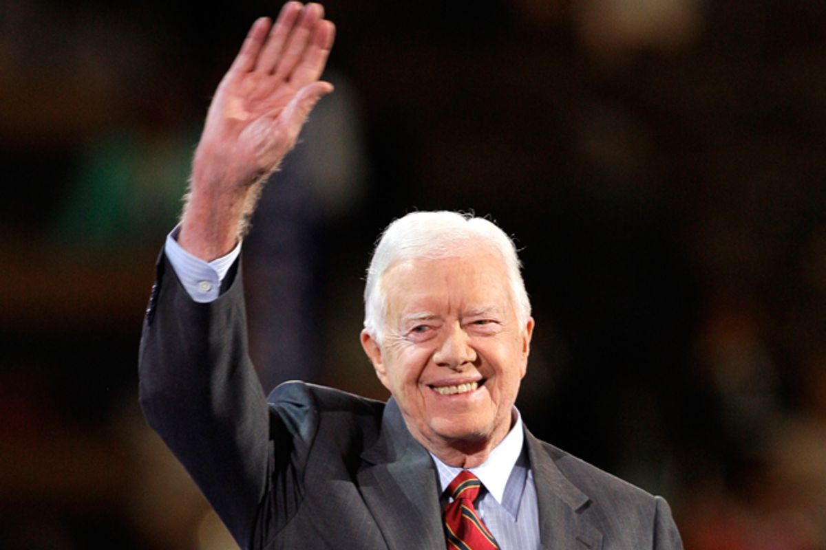 Former President Jimmy Carter waves to the crowd as he goes on stage at the Democratic National Convention in Denver on Aug. 25, 2008.   (AP/Paul Sancya)