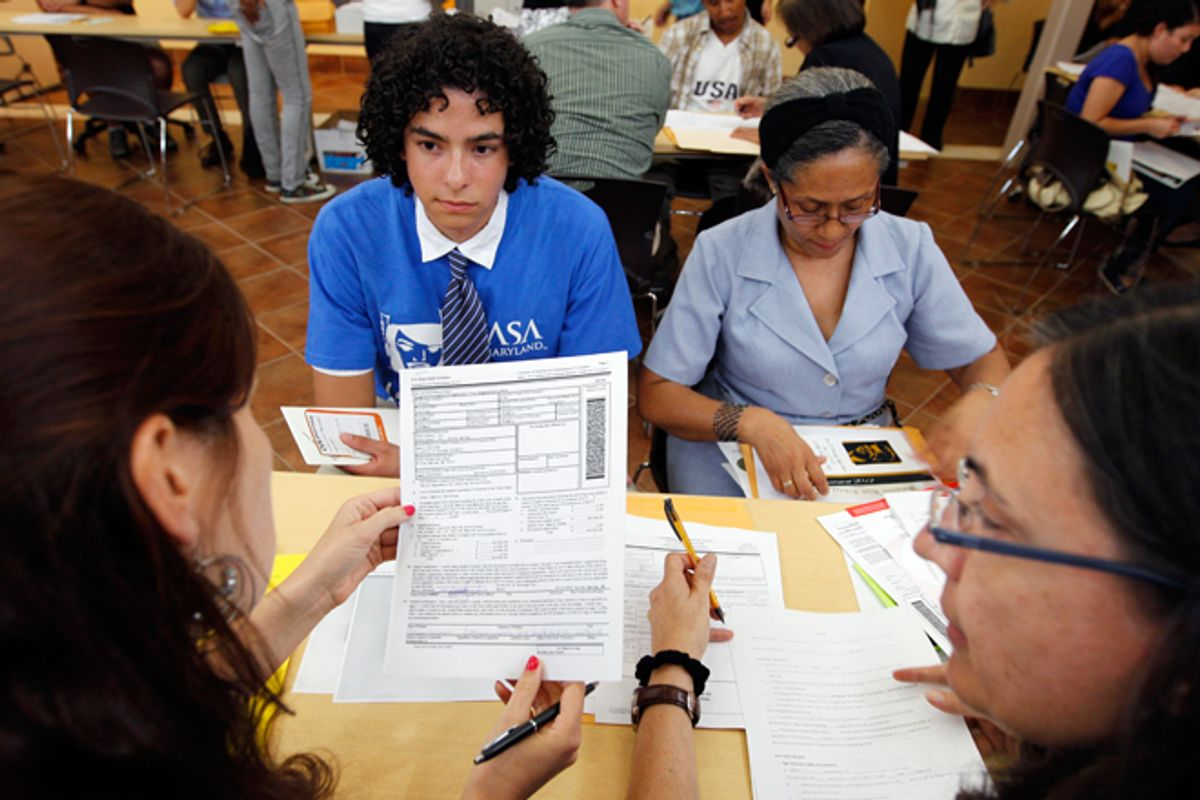 Colombian immigrants Daniel Nino, left, and his mother Patricia Cara get help filling Deferred Action Childhood Arrivals applications in Langley Park, Md.   (AP/Jose Luis Magana)