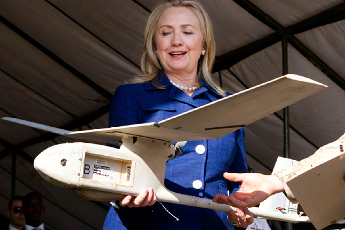 Hillary Clinton holds a small U.S.-made drone that the Ugandan military uses in Somalia to fight al-Qaeda linked militants.           (Reuters)