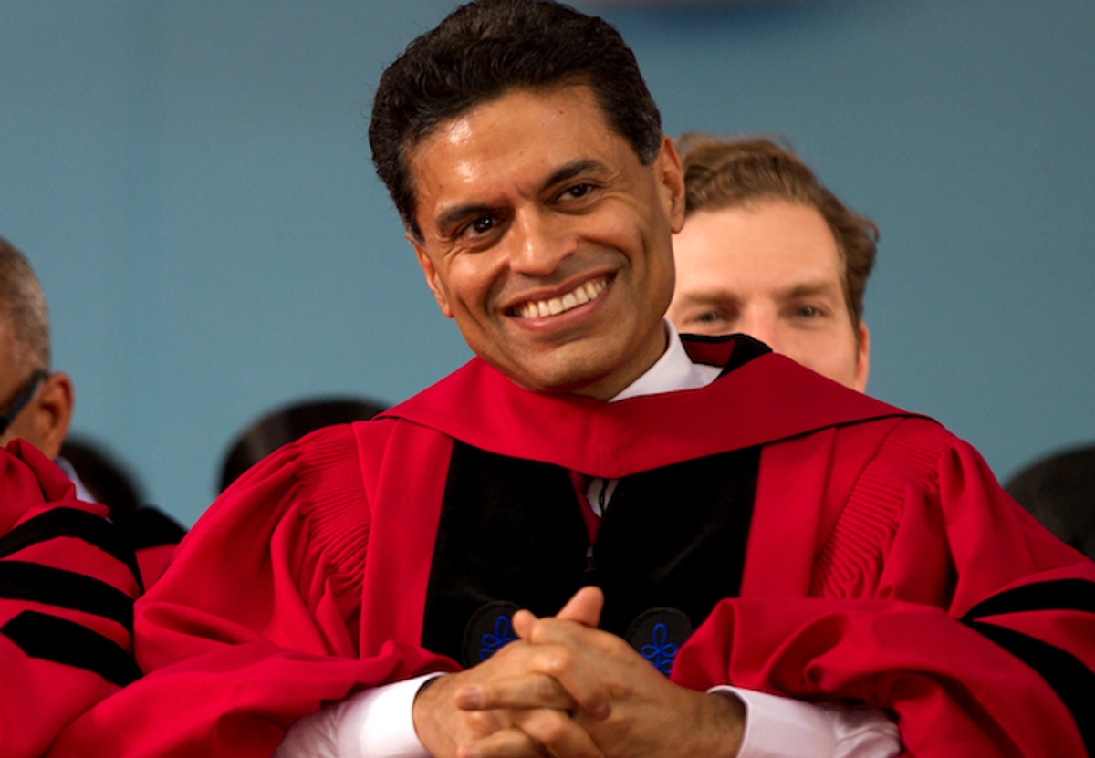 Journalist Fareed Zakaria is seated during Harvard University commencement exercises before being awarded an honorary Doctor of Laws from the University, in Cambridge, Mass., Thursday, May 24, 2012.  (AP/Steven Senne)