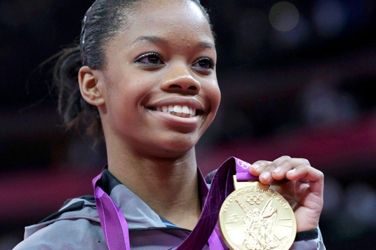 U.S. gymnast Gabrielle Douglas displays her gold medal   (AP/Julie Jacobson)
