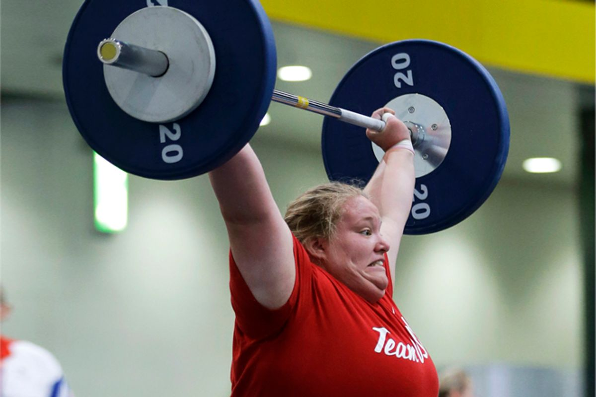 Weight-lifter Holley Mangold, of the United States, trains in preparation for the start of the 2012 Summer Olympics     (AP/Hassan Ammar)