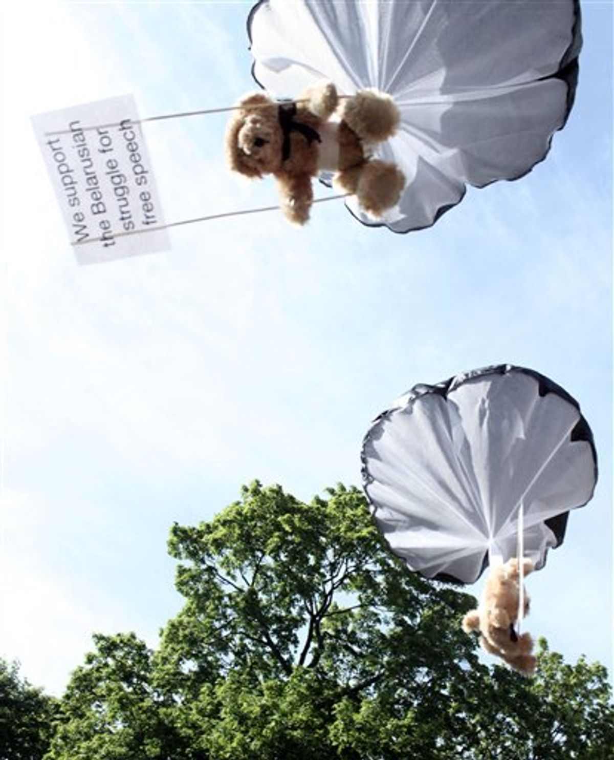 Studio Total teddy bears hang on parachutes during a training in Stockholm, Sweden. (AP/Studio Total/Per Cromwell)