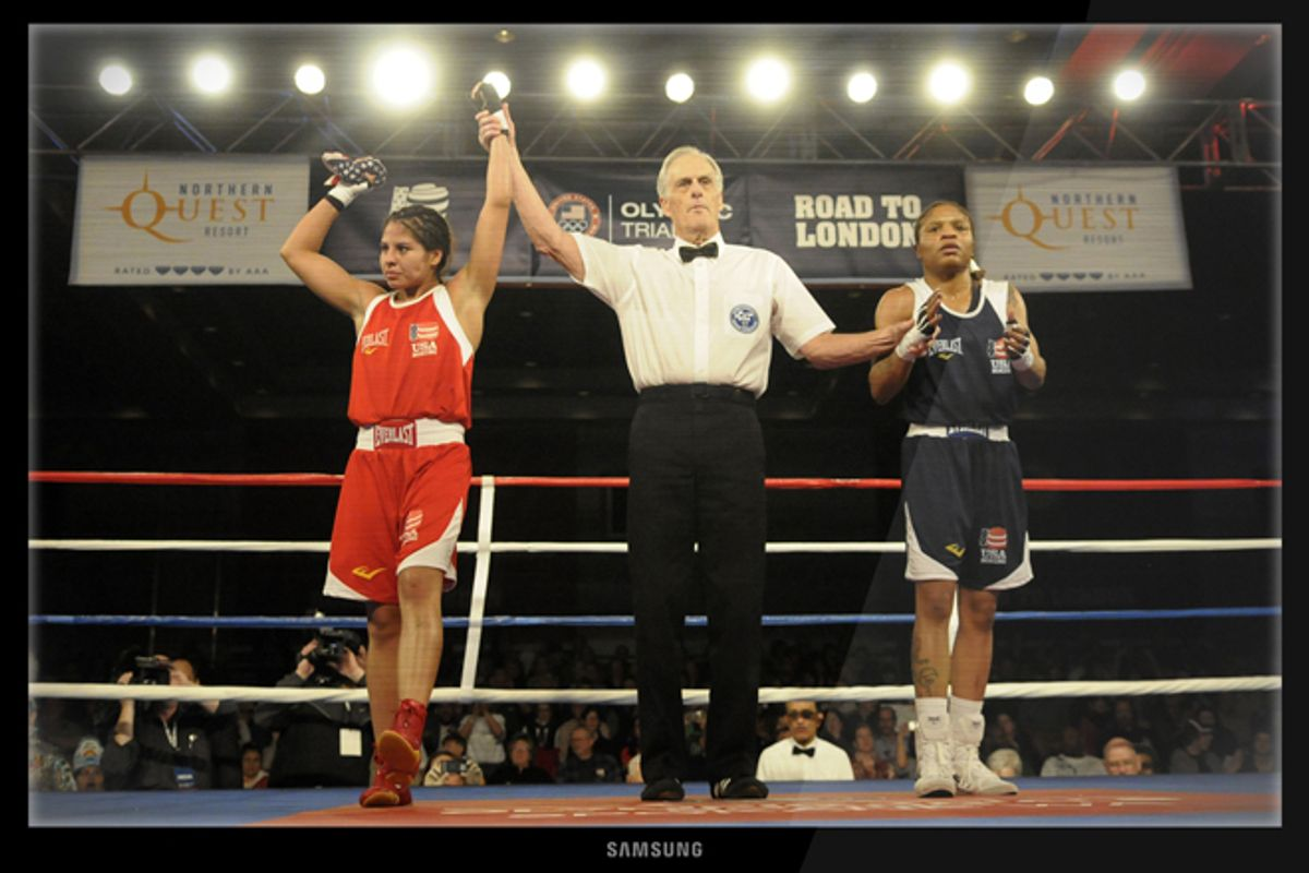 Marlen Esparza, left, and Tyriesha Douglas during a flyweight boxing match at the U.S. Olympic women's boxing team trials on Feb. 18, 2012.     (AP Photo/Jed Conklin)