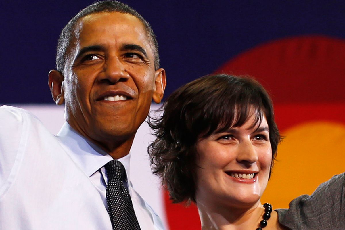Barack Obama and Sandra Fluke during an election campaign rally in Denver on Wednesday.      (Reuters/Jason Reed)