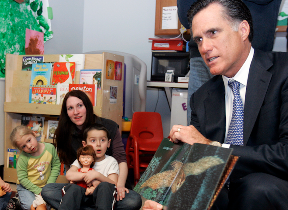 Republican presidential candidate and former Massachusetts Governor Mitt Romney (R) reads a book to children in a childcare program at the state's Easter Seals headquarters in Manchester, New Hampshire April 3, 2007.             (REUTERS/Brian Snyder)