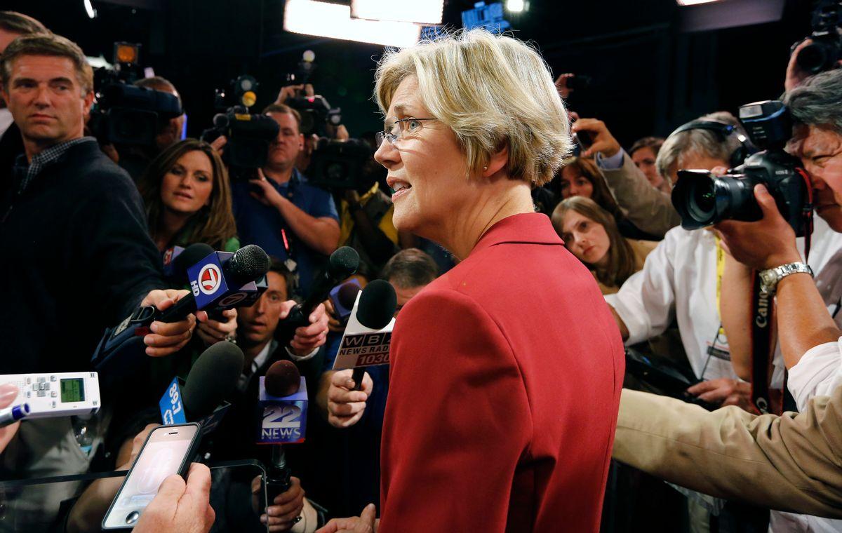 Elizabeth Warren talks with reporters following her debate with Sen. Scott Brown, R-Mass.   (AP /Michael Dwyer)