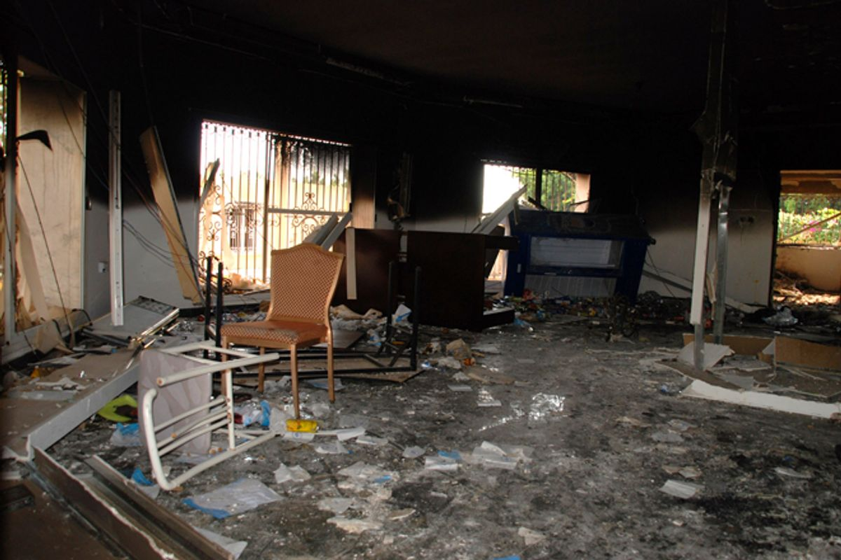 Glass, debris and overturned furniture are strewn inside a room in the gutted U.S. consulate in Benghazi, Libya.    (AP/Ibrahim Alaguri)