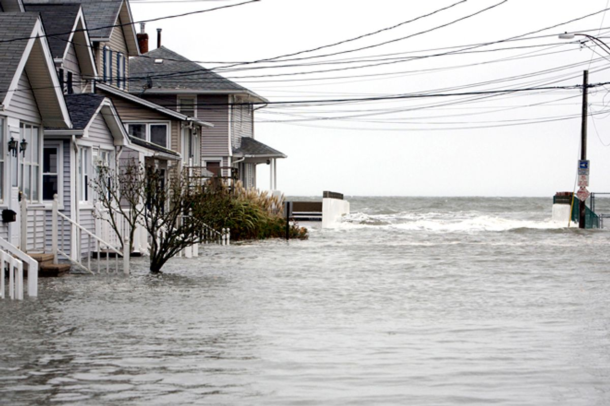 High tide begins to flood a street on the shoreline area of Milford, Conn., as Hurricane Sandy approaches Oct. 29, 2012.      (Reuters/Michelle Mcloughlin)
