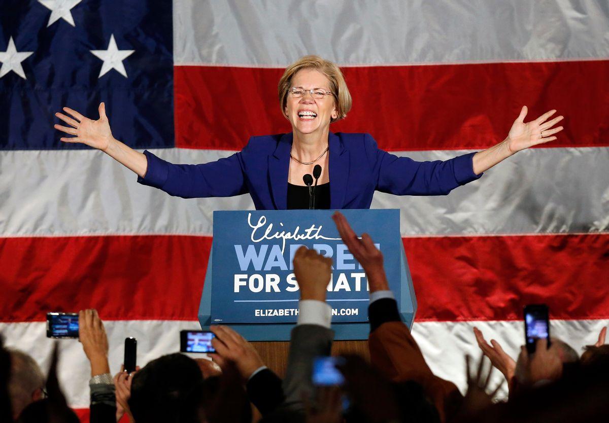 Democrat Elizabeth Warren takes the stage after defeating incumbent GOP Sen. Scott Brown in the Massachusetts Senate race.      (AP/Michael Dwyer)