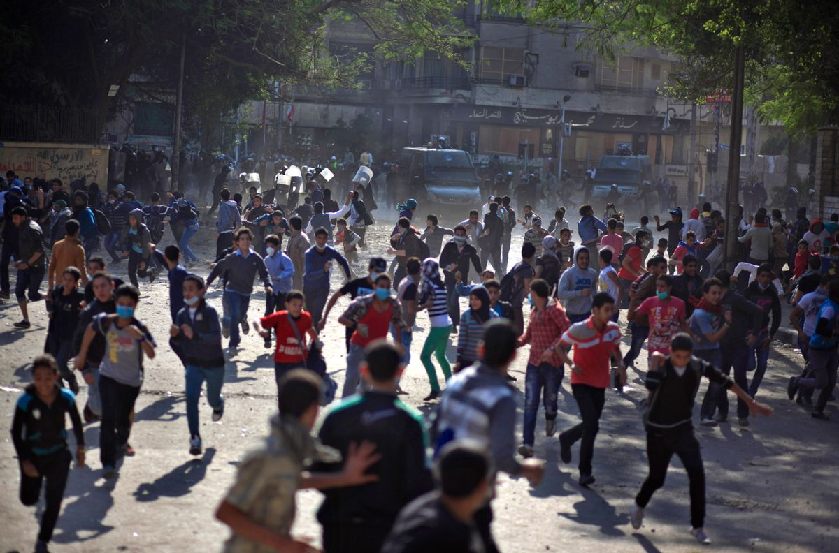 Egyptian protesters clash with security forces near Tahrir square, in Cairo, Egypt.          (AP/Khalil Hamra)