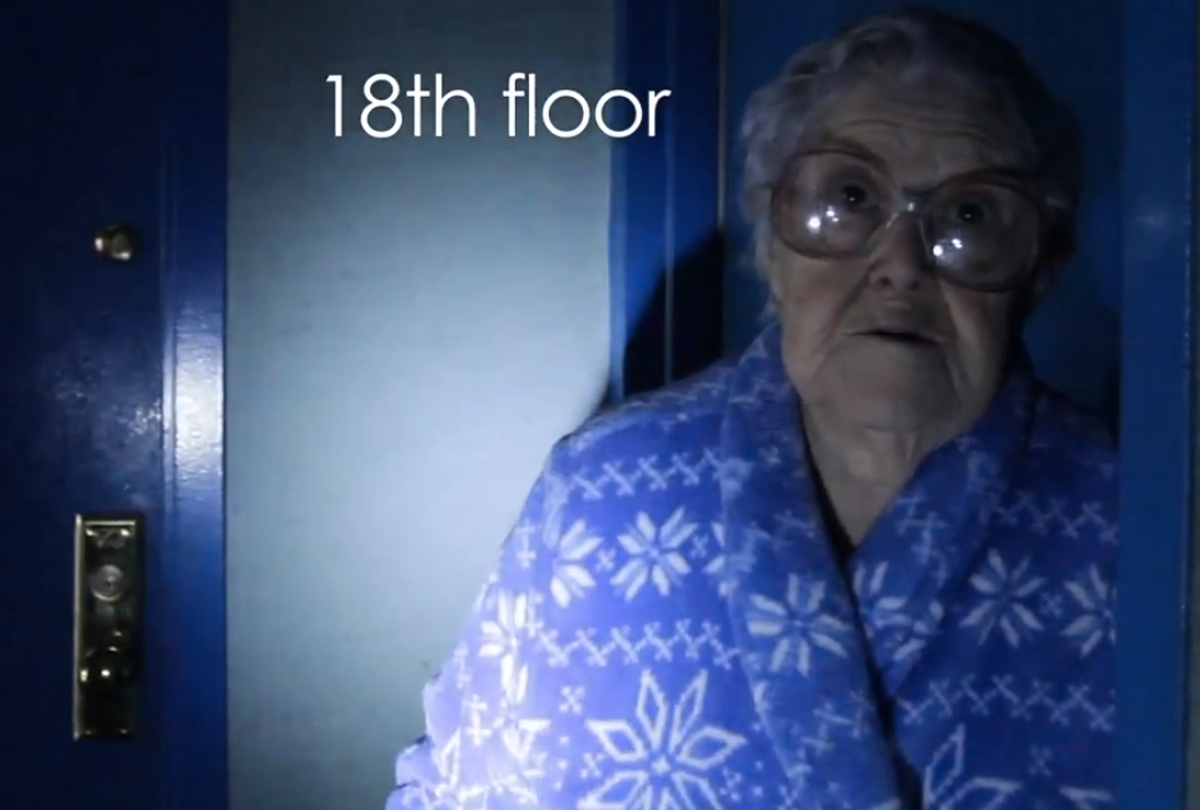 A woman outside her Rockaway apartment, still without power after Sandy (screenshot from YouTube/Kate Baladina)