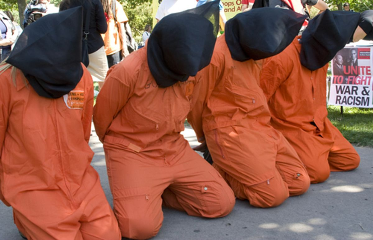 Guantanamo protesters kneel during the Democratic National Convention 2008  (Shutterstock/ Lilac Mountain)