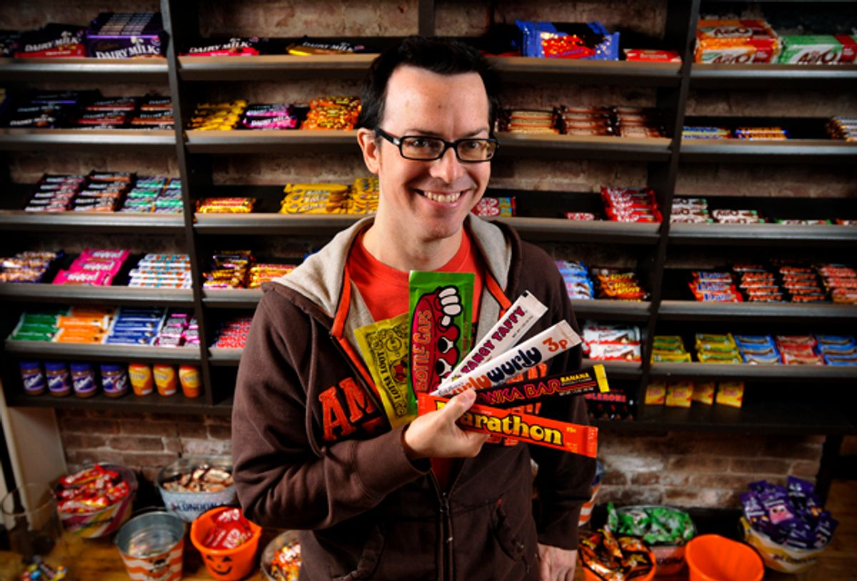 Jason Liebig holds a few pieces from his candy wrapper collection in the London Candy Company on the Upper East Side. Photos by Brad Horrigan.