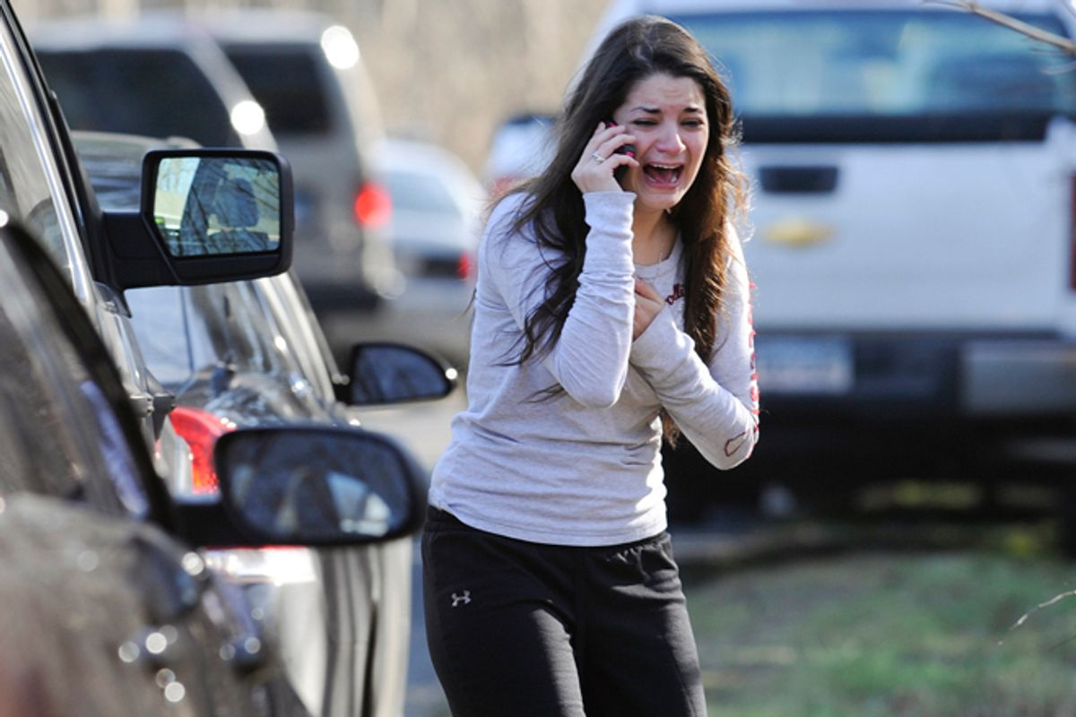 A woman waits to hear about her sister, a teacher, following a shooting at the Sandy Hook Elementary School in Newtown, Conn., Friday, Dec. 14, 2012.                 (AP/Jessica Hill)