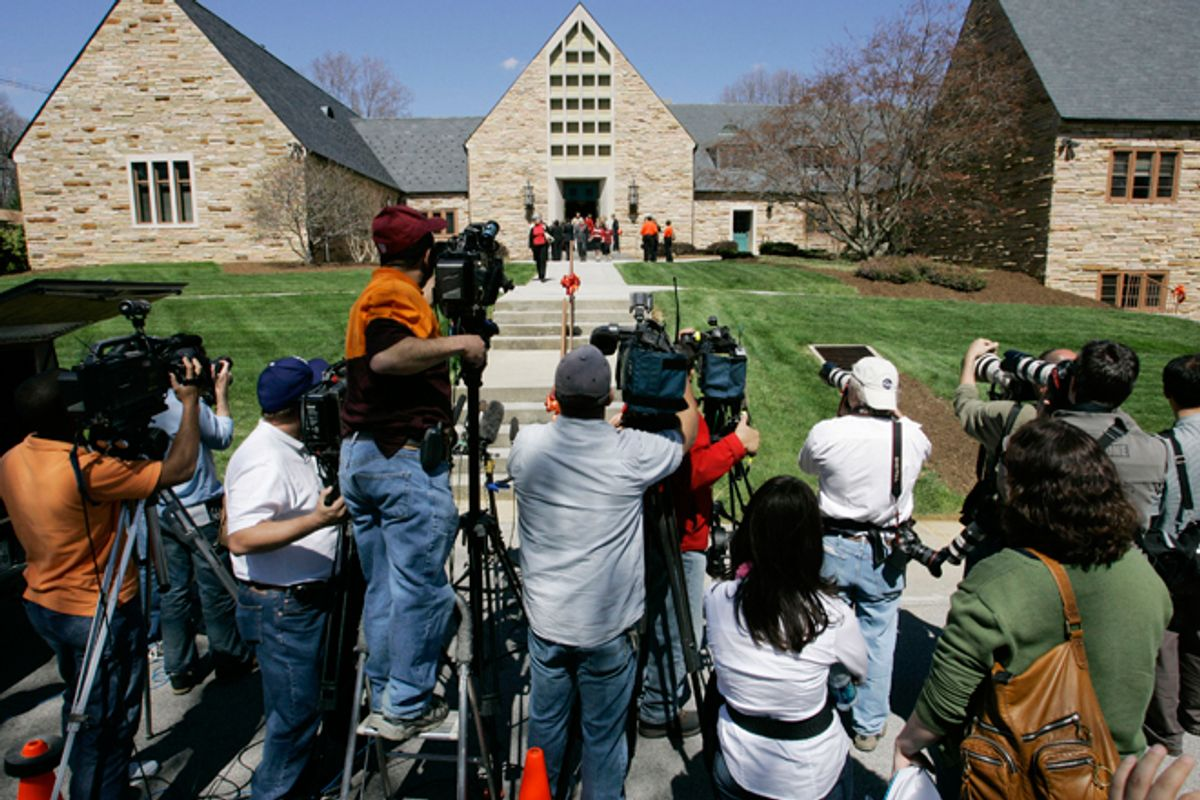 Members of the media photograph mourners as they emerge from Blacksburg Presbyterian Church after the memorial service for Virginia Tech shooting victim Kevin P. Granata in Blacksburg, Va., Friday, April 20, 2007. The service was closed to media cameras at the request of the family.      (AP/Charles Dharapak)