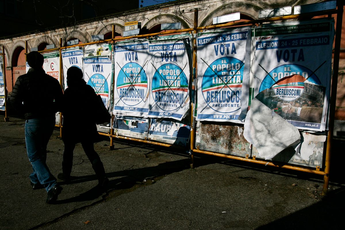 """A couple walks past electoral posters of People of Freedom party reading: """"February 24-25 Vote People of Freedom, Berlusconi for President"""", in Rome.    (AP/Gregorio Borgia)"""