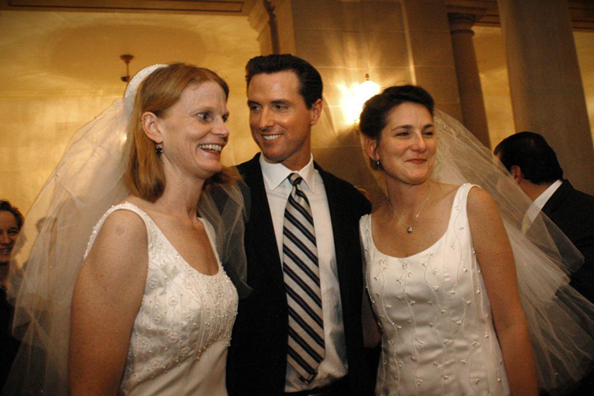 Gavin Newsom with a newly married couple in San Francisco in 2004.       (AP/Erin Lubin)
