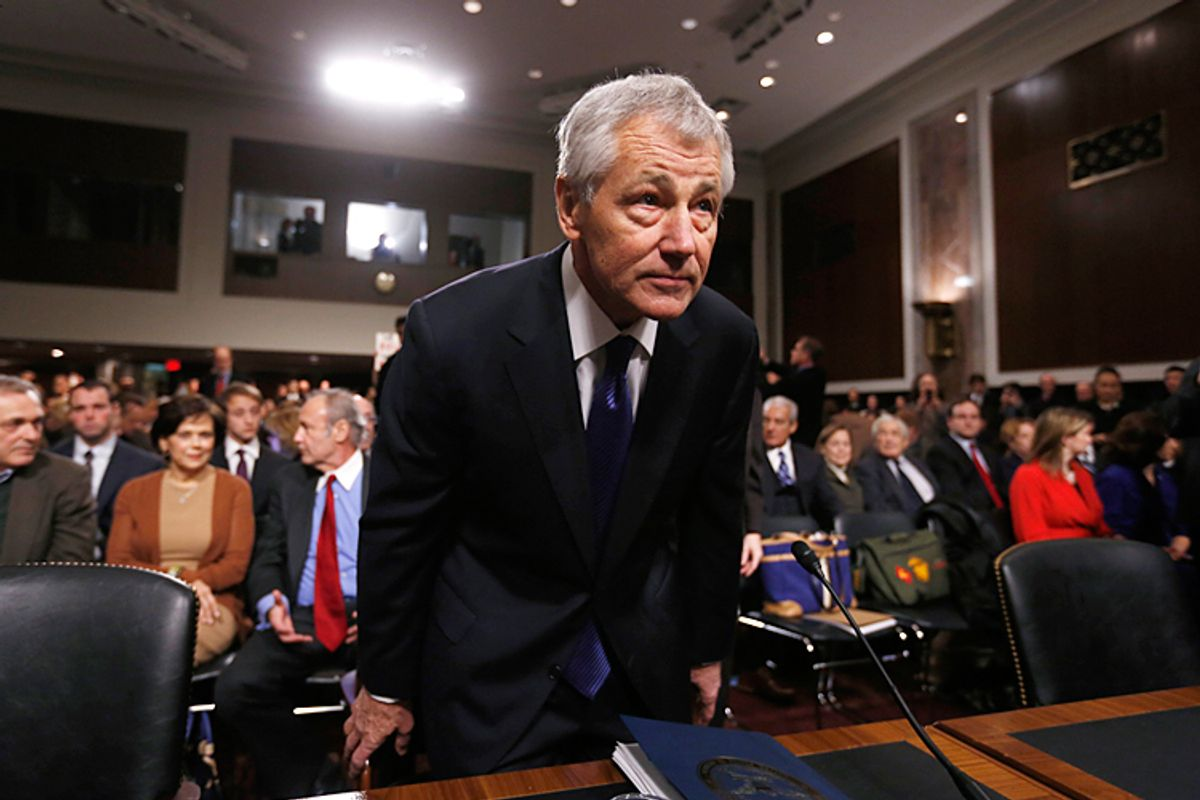Former Sen. Chuck Hagel (R-NE) sits down before giving testimony to the Senate Armed Services Committee. Republicans have taken unprecedented action to block his secretary of defense nomination. <BR>Credit: Reuters/Kevin Lamarque