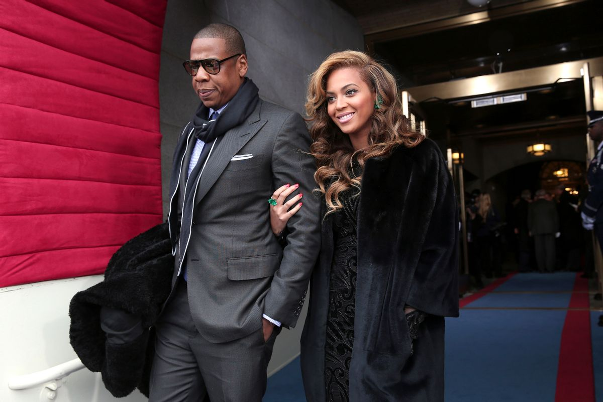 FILE - This Jan. 21, 2013 file photo shows recording artists Jay-Z and Beyonce at the Capitol in Washington for the Presidential Barack Obama's ceremonial swearing-in ceremony during the 57th Presidential Inauguration. Jay-Z and Beyonce sat tightly with Solange. Kelly Rowland embraced Beyonce with a huge hug. And Rihanna spilled some of her drink laughing with Rowland as Music's top stars attended the annual pre-Grammy Roc Nation brunch on Saturday, Feb. 9, at the Soho House in Los Angeles on the eve of the Grammy Awards.  (AP Photo/Win McNamee, Pool, file)           (AP)