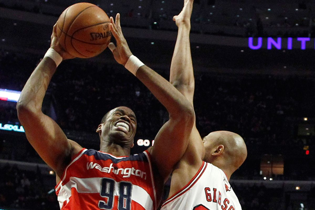 Jason Collins fights to the basket against Chicago Bulls' Taj Gibson, April 17, 2013.        (Reuters/Jim Young)