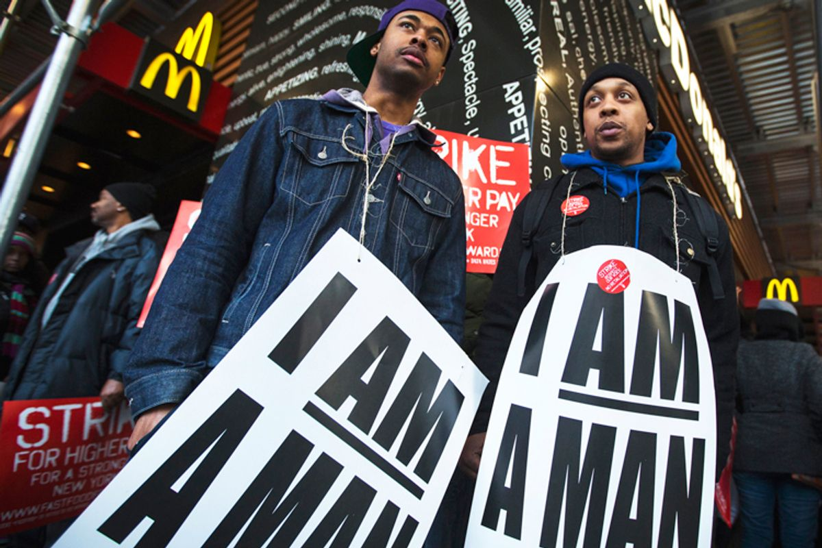 Demonstrators protesting low wages and the lack of union representation in the fast food industry stand outside McDonald's in New York, April 4, 2013.                (Reuters/Lucas Jackson)
