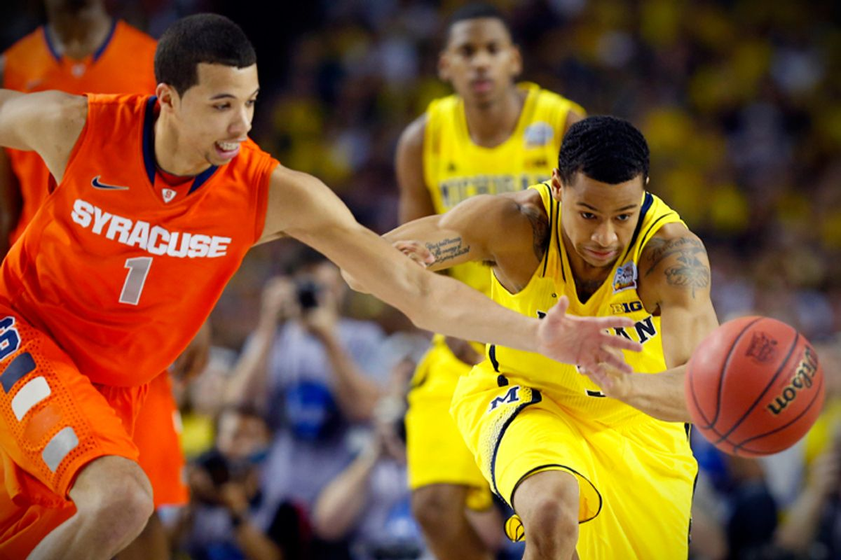 Syracuse's Michael Carter-Williams and Michigan's Trey Burke lunge for the ball during their Final Four game on April 6.  (Reuters/Chris Keane)