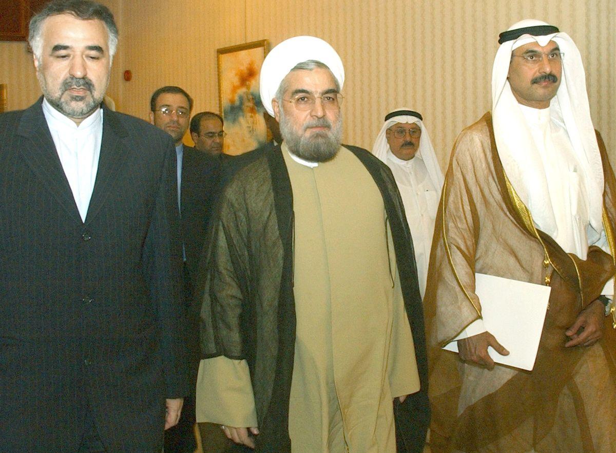 Secretary of Iran's National Security Supreme Council Hassan Rouhani, center  (AP/Gustavo Ferrari)
