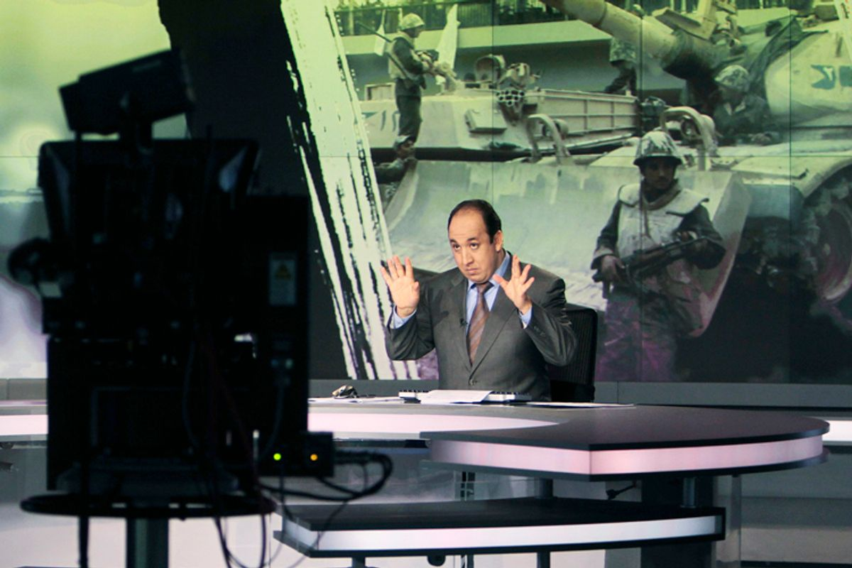 Announcer Abdul Samad Nasser, in the studio of the Arabic Al Jazeera satellite news channel.   (Reuters/Fadi Al-assaad)