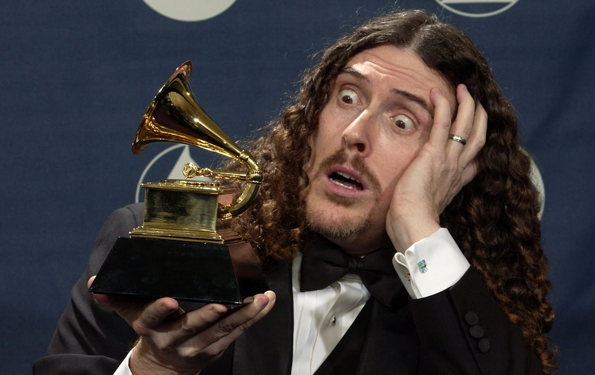 """""""Weird Al"""" Yankovic clowns around with the award he won for best comedy album for """"Poodle Hat"""" at the 46th Annual Grammy Awards, Sunday, Feb. 8, 2004, in Los Angeles. (AP Photo/Reed Saxon)  (AP/Reed Saxon)"""