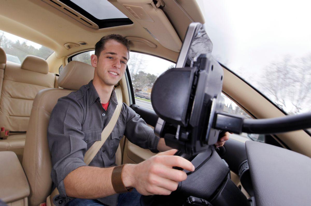 Ben Gleitzman uses a traffic and navigation app called Waze as he drives to work in Menlo Park, Calif.   (AP/Paul Sakuma)