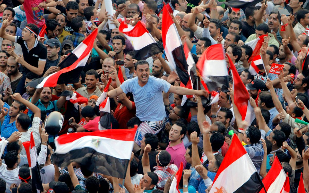 Opponents of Egypt's Islamist President Mohammed Morsi shout slogans and wave a national flags in Tahrir Square in Cairo, Egypt, Wednesday, July 3, 2013.  (AP/Amr Nabil)