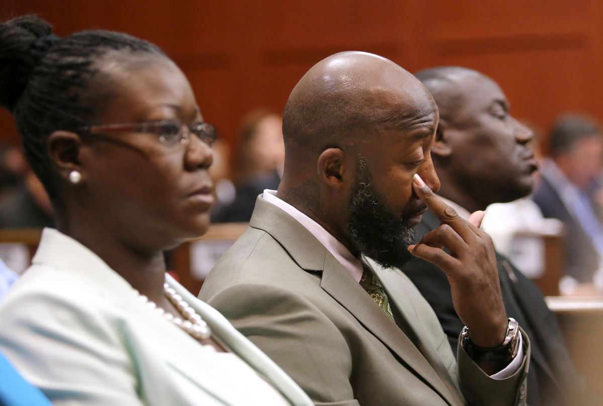 Trayvon Martin's mother, Sybrina Fulton, and father, Tracy Martin, watch the prosecution's rebuttal closing arguments during George Zimmerman's trial.                          (Reuters)
