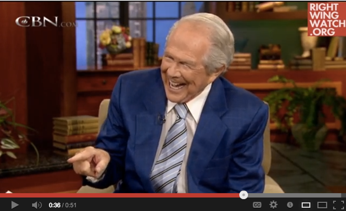 """Pat Robertson, demonstrating how one """"punches"""" or """"switches on"""" Facebook """"Likes""""       (Right Wing Watch)"""