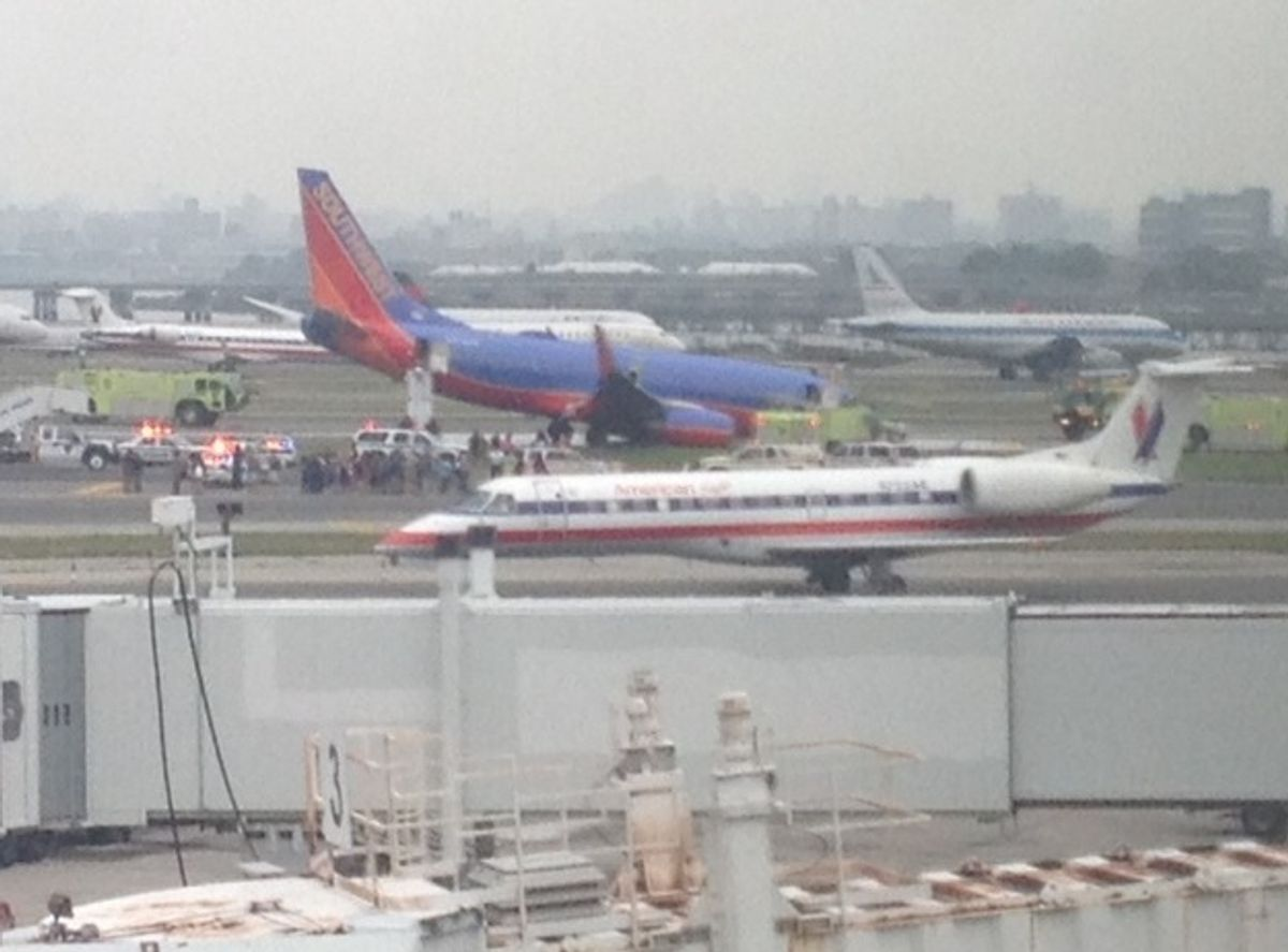 Southwest plane surrounded by first responders at Laguardia Airport  (Matt Sussberg)