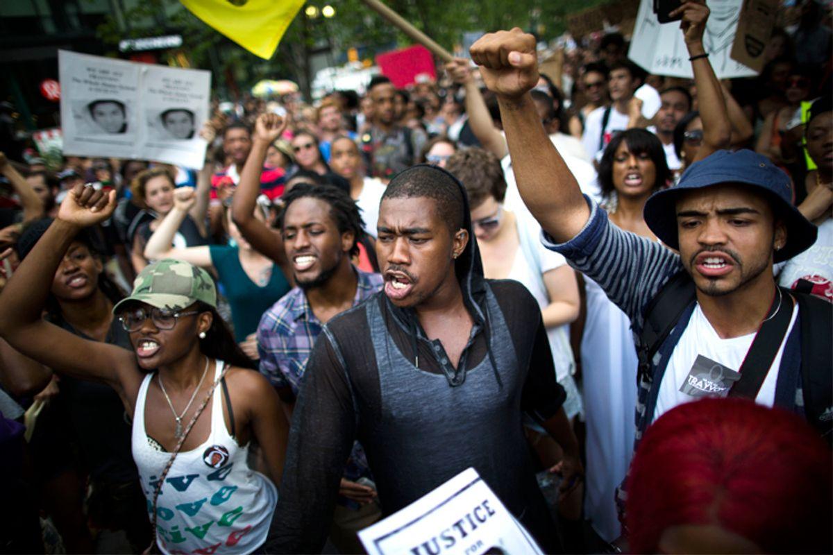 Zimmerman verdict demonstrators march toward Times Square           (AP/John Minchillo)